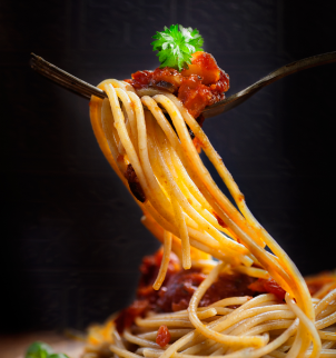 Photo of a fork full of spaghetti noodles and meat sauce