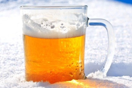 Photo of a mug of beer in the snow